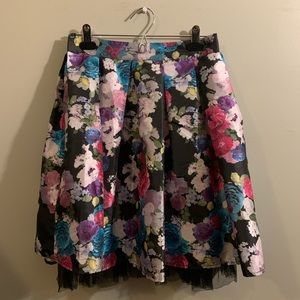 Multi-colored skirt with tulle underlay.